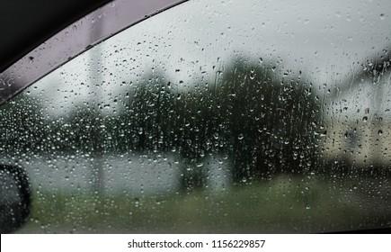 Autumn rain, sweaty glass. a drop of rain on the car window. Rain water drops on a glass surface background, Abstract Backdrop