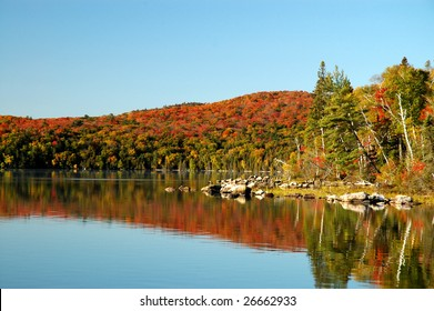 Autumn reflection on Flack Lake, Ontario