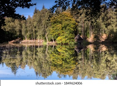 Autumn reflections in Faskally Woods Pitlochry, Scotland Uk