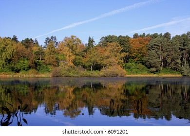 Autumn reflections in Nelly Moss Lake Cragside House Rothbury Northumberland