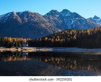 Autumn reflections on the lake Lej da Staz, Engadine Saint Moritz, Switzerland