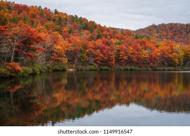 Autumn reflections at Sherando Lake, near the Blue Ridge Parkway in George Washington National Forest, Virginia.