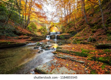 Autumn river with beautiful cascades of water and an old bridge near Sitovo village, Bulgaria