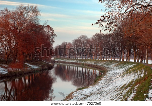 autumn river with snow