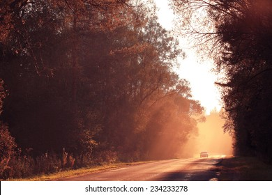 Autumn road sunset, the rays of light, the journey