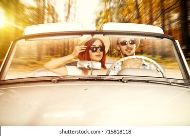 autumn road and two lovers in cabriolet