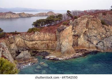Autumn, rocks, pines, sea, islands. Gamow Peninsula. Primorye. Russia.