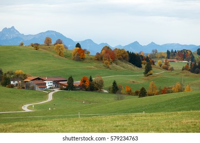 Autumn rural landscape in Bavaria, Germany with blue mountains far in the distance