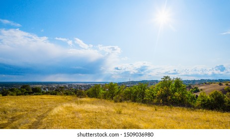 Autumn rural nature landscape with steppe grass and sunny sky