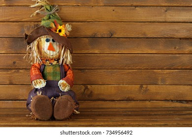 Autumn Scarecrow on wooden background