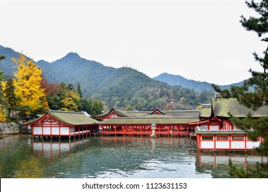Autumn scene of the centuries-old Itsukushima shrine on Miyajima island which seemingly floating in the sea during high tide. This shrine is one of the most visited  landmarks in Japan.