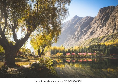 Autumn scene of morning in lower Kachura lake with mountains in the background and reflection in still water. Shangrila Skardu. Gilgit-Baltistan, Pakistan.