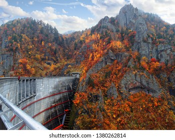 Autumn scenery of colorful maple trees on the rocky cliffs by Hoheikyo Dam in a beautiful gorge under environmental protection in Shikotsu-Toya National Park, in Sapporo, Hokkaido, Japan