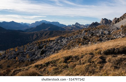 Autumn scenery in Dolomites mountains at mountain pass Giau.