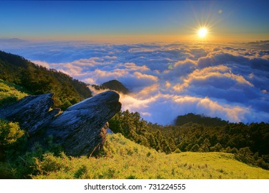 Autumn scenery of Hehuan Mountain Main Peak.With Arrow bamboo field along the Trails of Taroko National Park,Sunset shine on Qixiandeng(cliff) and sea of clouds is Taiwan aesthetic sense.Hualien,Asia.