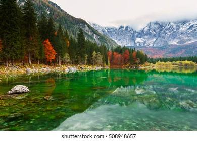Autumn scenery at lake Fusine ( Lago di Fusine) mountain lake  in north Italy in the Alps.
