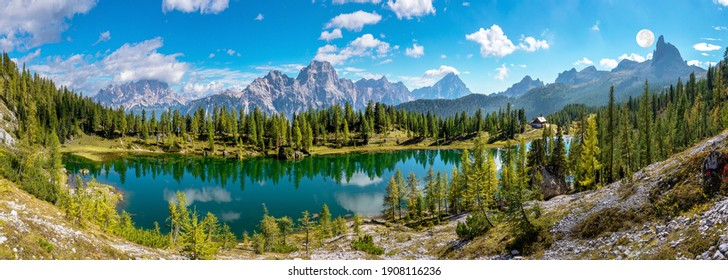 Autumn scenery with lake reflection in the Dolomites mountains at Lake Federa