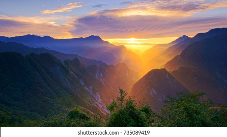 Autumn scenery of Xinbaiyang in Taiwan Central Cross-Island Highway 139K.Crepuscular ray shine on the gorge of Taroko National Park with morning cloud compose the Taiwan aesthetic elegant sense.