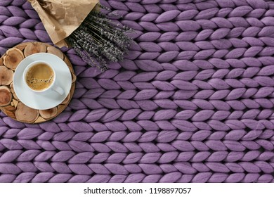 Autumn season concept of cozy home, hot coffee on merino plaid, top view, copyspace