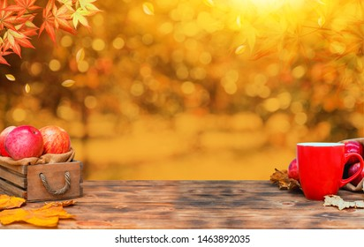 Autumn season with fruit and vegetable. Fall harvest cornucopia. Apples and hot tea with natural background