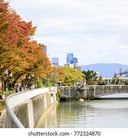 Autumn season with The high office building has an intermediate river at Osaka, Japan