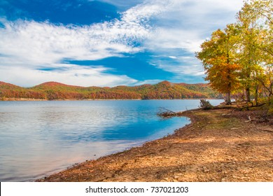 Autumn season at lake with beautiful forest at hill shore.