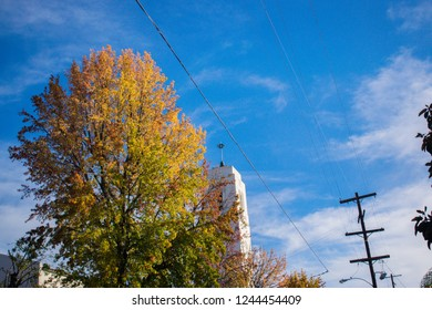 Autumn season with an old historic church in the back ground.