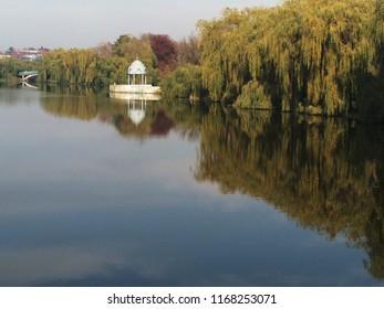 autumn season, autumn park over a lake, summerhouse