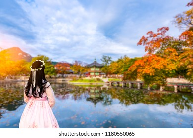 Autumn in Seoul City with Korean national dress at Gyeongbokgung Palace Seoul,South Korea.