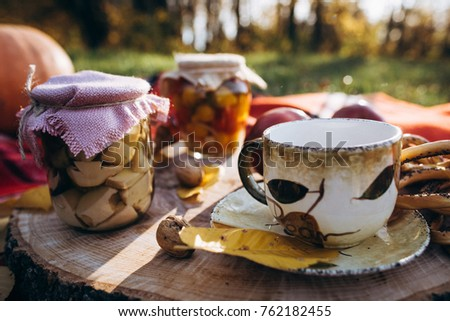 efeb90c705b Autumn set. Leaves, nuts, tea in a cup, canned mushrooms, vegetables