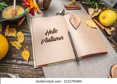 Autumn set of yellow leaves and flowers. Notebook with open pages on the table. Space for text. Top view. Concept Hello autumn