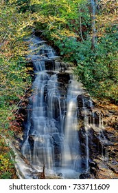 Autumn shot of Soco Falls in Cherokee County, North Carolina, vertical panorama.