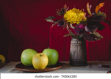 Autumn still life apples, autumn flowers and leaves
