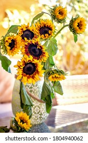 Autumn still life. Autumn bouquet of flowers with sunflowers.