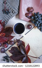 Autumn still life in burgundy tones. Autumn or winter concept, lifestyle blogers.Flat lay, top view.