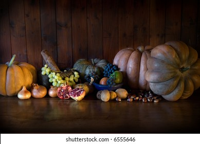 Autumn still life with pumpkins, grapes, onions, chestnuts and other