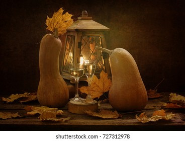 Autumn still life with pumpkins and the old lantern