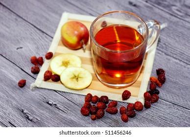 Autumn still life with tea mug and apples, vitamin c