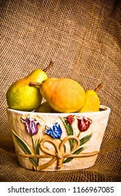 autumn still-life with pears in old bowl
