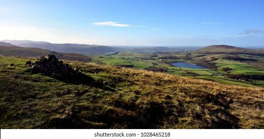 Autumn sunlight on Binsey from Longlands Fell