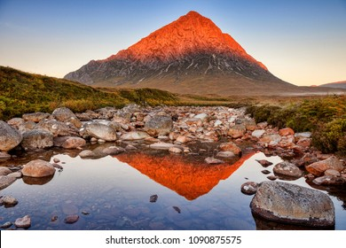 Autumn sunrise at Buachaille Etive Mor, perfectly  reflected in the Coupall River, Glencoe, Lochaber, Highlands, Scotland, UK.