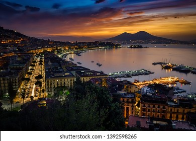 An autumn sunrise, with Mount Vesuvius in the background, in Naples, Italy.