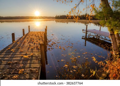 Autumn sunrise over dock on Moose lake in northern Wisconsin.