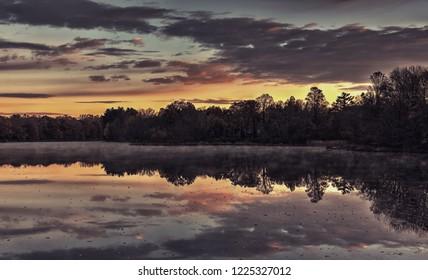 Autumn sunrise over Farrington Lake in East Brunswick, New Jersey.
