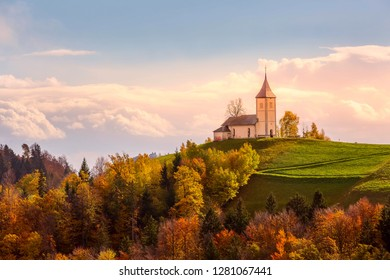 Autumn sunrise panorama with Saints Primus and Felician Church on top of hill in Slovenian countryside, Slovenia