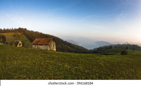 Autumn sunset at hillsides and meadow with mist over Danube river in Serbia