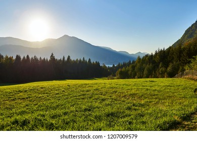 Autumn sunset lanscape in Austrian Alps with mountains and forest. Salzkammergut region.