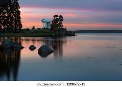 Autumn sunset in Monrepos park, Vyborg, Russia