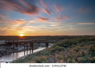 Autumn sunset over the popular Norfolk coast marshes, UK