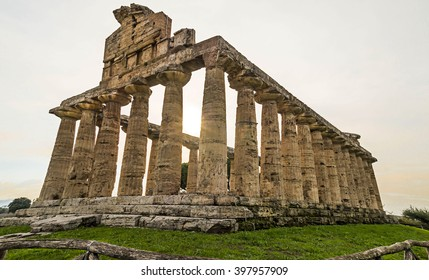 Autumn sunset at Paestum - UNESCO World Heritage Site, with some of the most well-preserved ancient Greek temples in the world, Italy. It's about three temples: Temple of Hera, Poseidon and Ceres.
